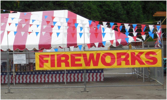 Rental fencing around a fireworks stand on the Fourth of July