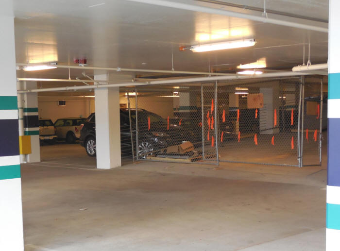Temporary fencing in the Seahawks stadium parking garage - custom built for drive ramp